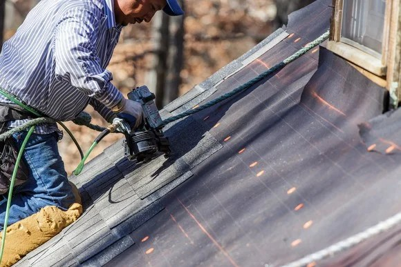 a man fixing a roof