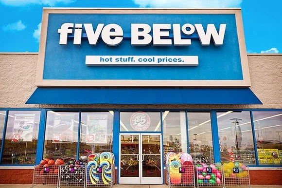 """Entrance of a Five Below store with its logo, """"Hot stuff. Cool prices."""""""