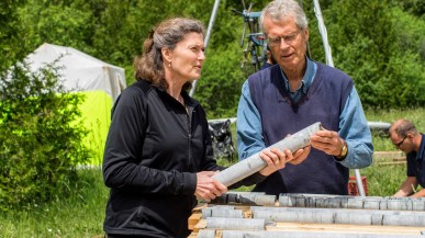 Beth Parker and John Cherry examining core in the field