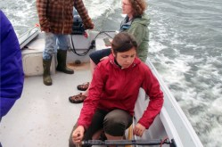 Masters student on the way to the field by boat