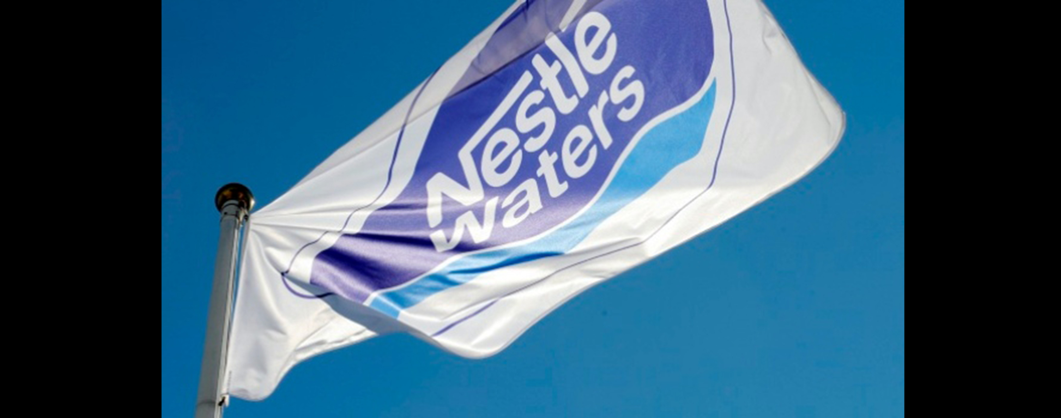 Photo of Nestle Flag blowing in the wind