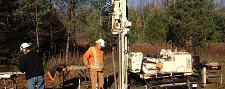 Photo of people working at the drill rig