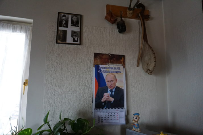 A calendar featuring Russian President Vladimir Putin hangs on the wall below the gusla — a traditional one-stringed instrument — of Milutin Petrušić, a resident of the recently renamed Serbian hamlet of Putinovo | Valerie Hopkins