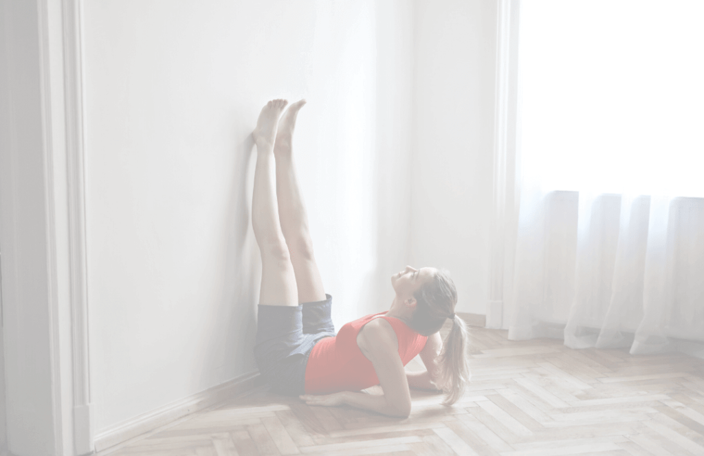 Woman exercising on a wall