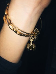 alex and ani gold lobster and gold oval beaded bangles (i love the mix and match option that alex and ani offers, and the bangles are super inexpensive!)