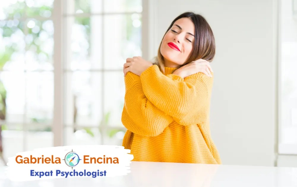 Coping with Expat Guilt in your Life Abroad - Gabriela Encina - Expat Psychologist Online - expat Woman hugging herself with love