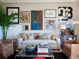 To merge Scott's style with Alex's style, the couple combined each of their own favorite pieces to create something truly unique. While the traditional-style furniture and modern art collection are from Scott's previous home, Alex's flair for all things mid-century modern makes its way into the room in the form of a chrome Milo Baughman coffee table.