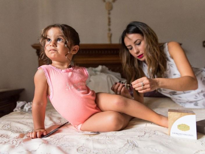 Bambina-Battesimo-Famiglia-6 Fotografo di Battesimo Cosenza Corigliano Rossano