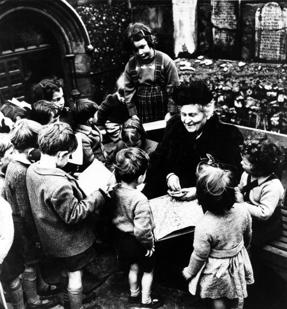 Italian educator Maria Montessori is surrounded by children as she visits a Montessori school in London, England, sometime in the late 1940s. (AP Photo)