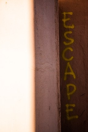 """""""ESCAPE"""" is spray painted on a wall adjacent to a men's shelter in Bushwick."""