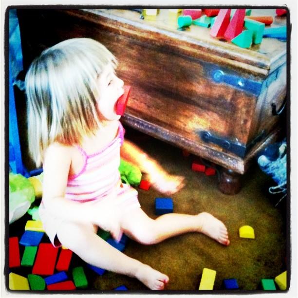 Emily eating her blocks