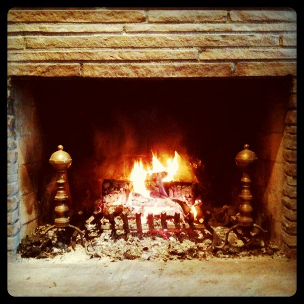 Is enjoying a lovely fire in Orinda on a drizzly day.