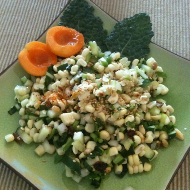 Tasty summer salad: fresh Brentwood corn, dinosaur kale, toasted pine nuts, cucumber with a sesame ginger raisin dressing