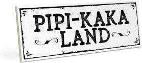 weißes Schild als Pipi Kaka Land Baddeko