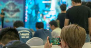 Young players compete in a battle match of the mobile game