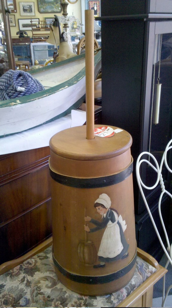 A meta churn - a butter churn with a painting of a butter churn on it.