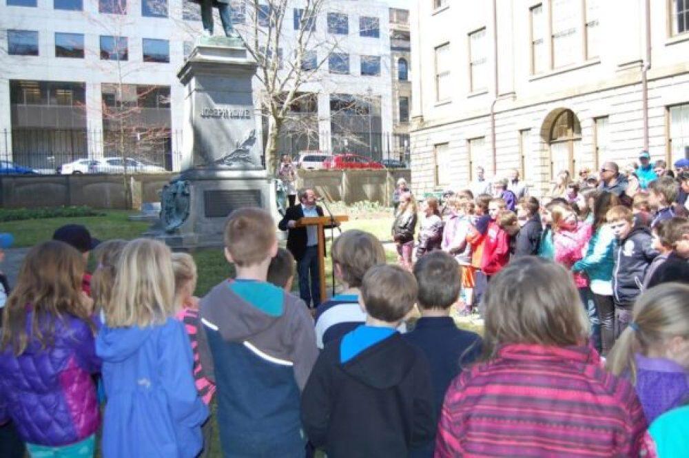 Lewis MacKinnon, Gaelic Affairs, emcees the Gaelic flag-raising event