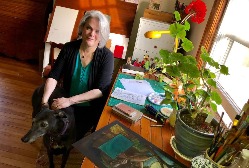 Anna Ruadh cover illustrator Etta Moffatt with her rescue greyhound Brooke and Bonny the geranium in her studio