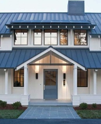 Incredible Farmhouse Exterior Ideas With Metal Roof 34