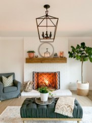 Delicate Living Room Design Ideas With Fireplace To Keep You Warm This Winter 22