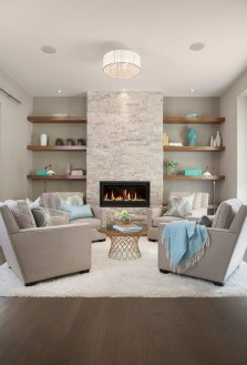 Delicate Living Room Design Ideas With Fireplace To Keep You Warm This Winter 33