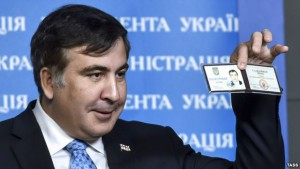 Former Georgian President Mikheil Saakashvili shows off his identification card as the head of an advisory council in Kyiv in February