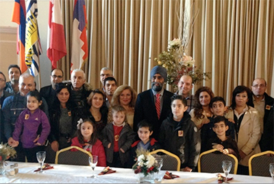Defence Minister Harjit Sajjan meets with newly-arrived Syrian refugees at St. Gregory Armenian Church in Richmond. (Catherine Rolfsen)