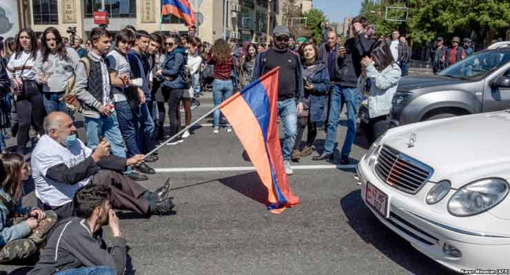 Opposition supporters block a street during a rally in central Yerevan on April 16.