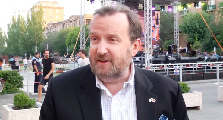 U.S. Ambassador Richard Mills talks to journalists in Yerevan on July 4.