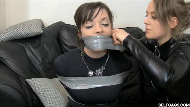 female catsuit burglar tape gags girl