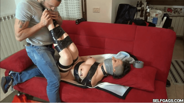 foot worships adorable feet while she is tape bound and gagged selfgags
