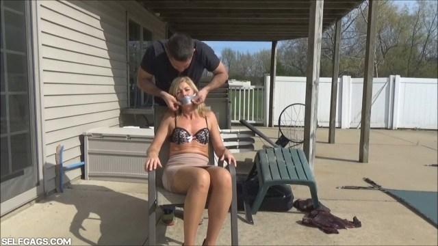 Milf Dakkota tape gagged on a chair selfgags