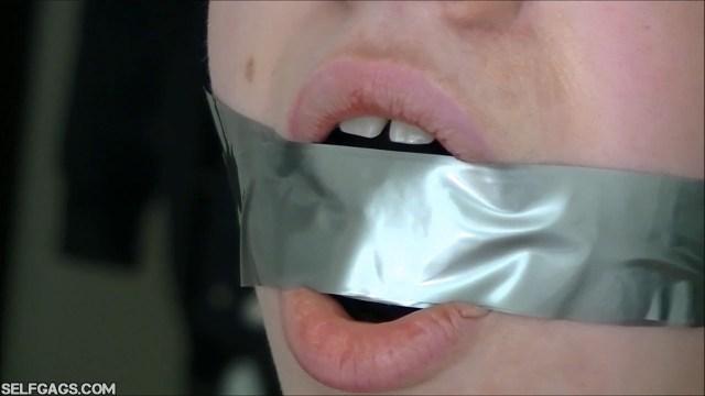 Close up of gagged girl selfgags