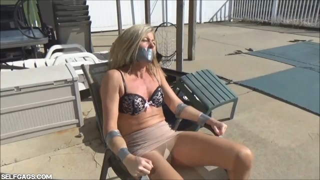 Dakkota Grey duct taped to chair and gagged selfgags