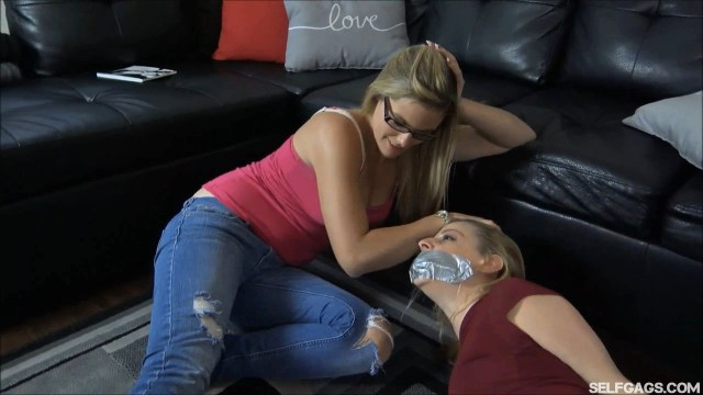 Sexy girl tape gagged in bondage selfgags
