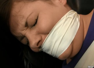 Tightly tape gagged girl crying