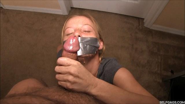 Tape gagged Alyssa Hart gives handjob and takes facial cumshot
