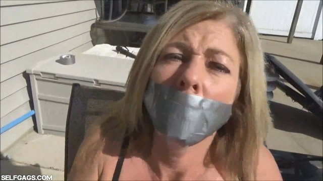 Tape gagged MILF Dakkota Grey selfgags