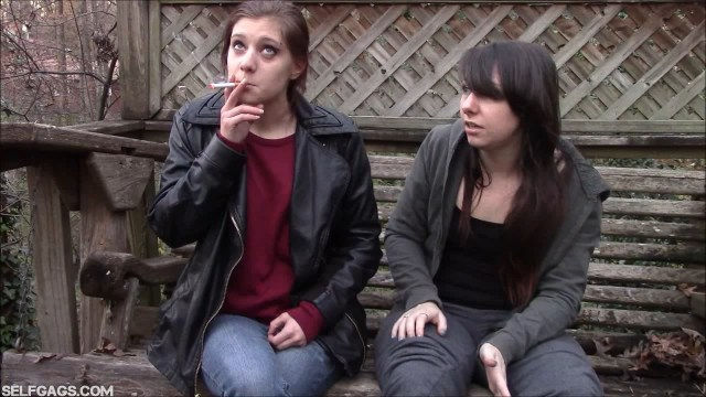 Little sister Gemi smoking a cigarette in front of big sister Dakota Charms