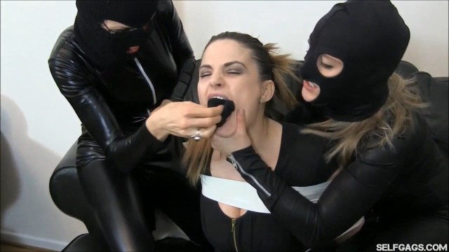 Girl is panty gagged by catsuit burglars