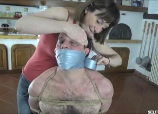 Femdom woman tape gagging man