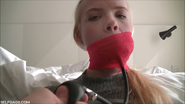 Wrap gagged blonde Vanessa with infltable gag in her mouth