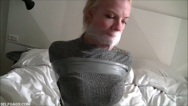 Blonde girl tape gagged tight