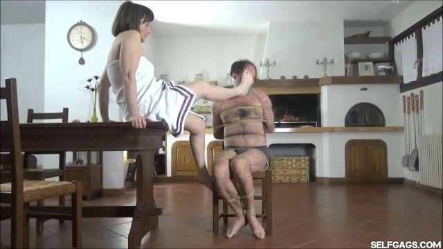 Woman make tied and gagged man smell her feet