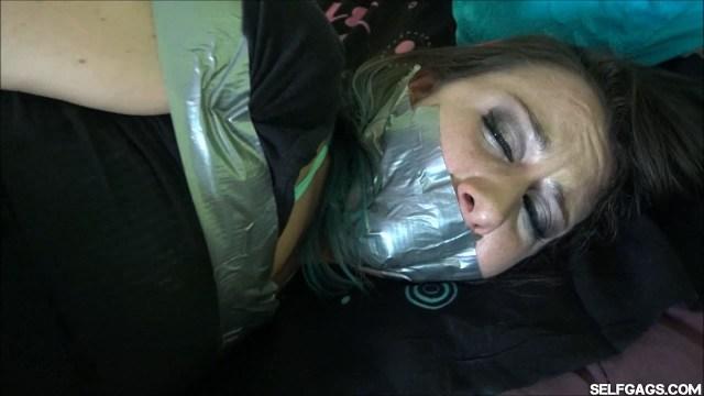 Tape gagged girl in bondage Dakota Charms selfgags