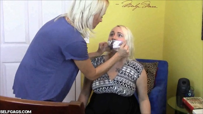 Blonde girl tape gagged by her mom