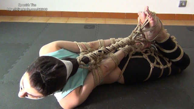 Hogtied girl in shibari bondage