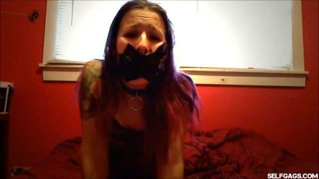 Collared slave girl tape gagged