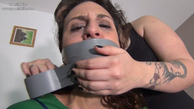 Girl is tape gagged with tape around the head