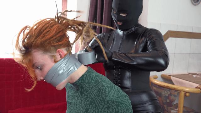 Redheaded girl tape gagged tight by catburglar